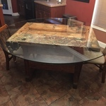 On Glass Table Top: 24 Inch Round 3/8 Inch Thick Beveled Edge Tempered