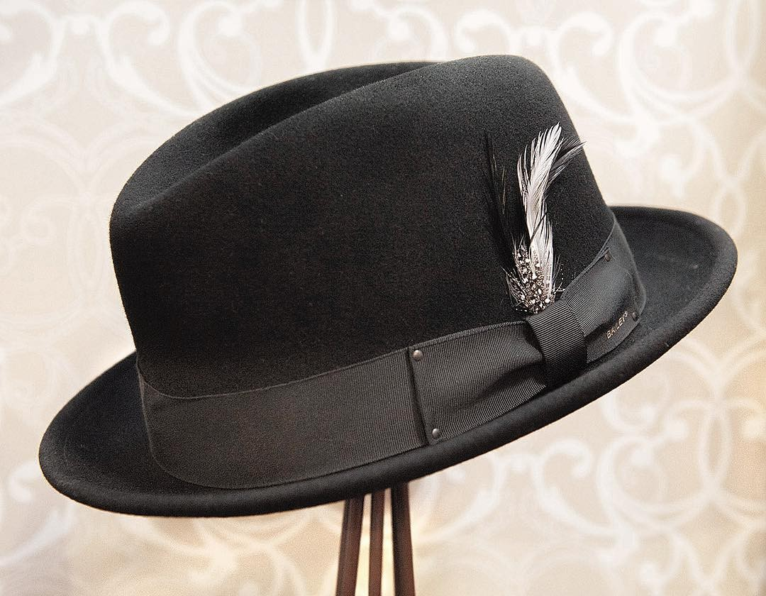 794c8c178c0a20 This snap brim fedora features our signature center dent crown and is  crafted out of our