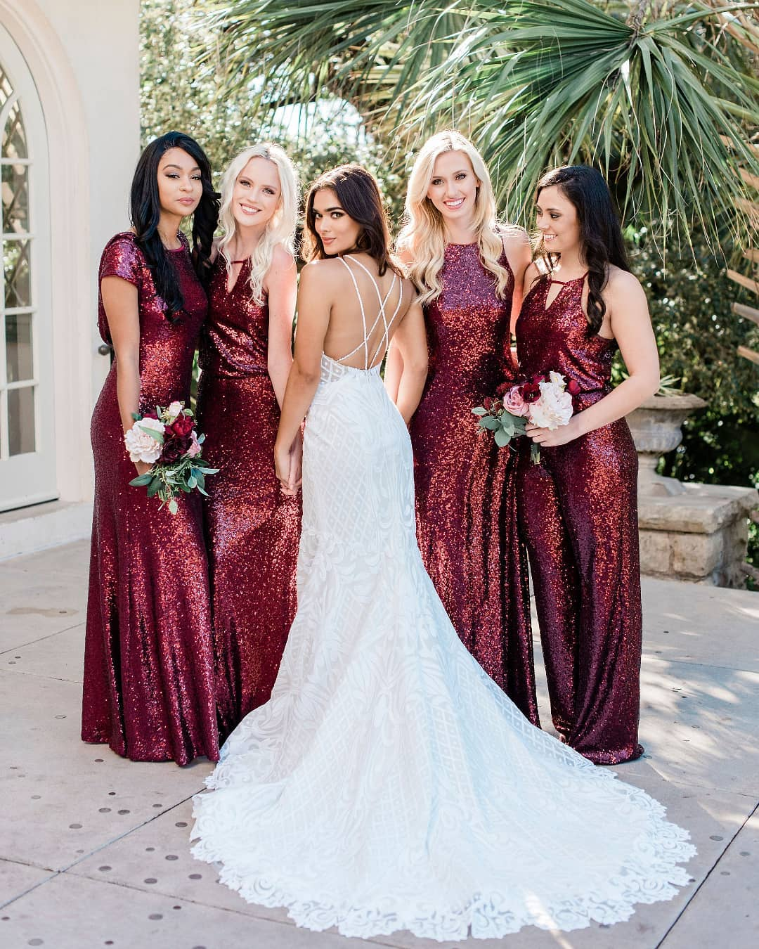 6a5d3a5acebc45 Modern Grecian goddess vibes in these glittery cabernet bridesmaid gowns  from shoprevelry! And that strappy